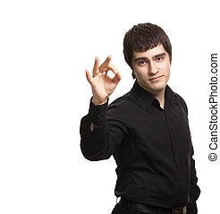 Portrait of young man in black shirt gesturing ok sign...