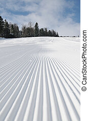 tracks on ski slopes at beautiful sunny winter day - tracks...