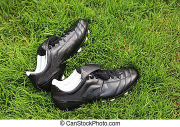 Soccer Shoes - Pair of soccer shoes on grass field