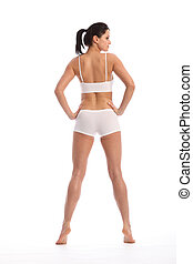 Rear view beautiful woman in sports lingerie - Rear view of...