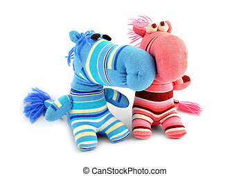 two soft toy on a white background