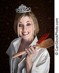 Grinning Lady Holding Spatulas - Grinning gorgeous Caucasian...