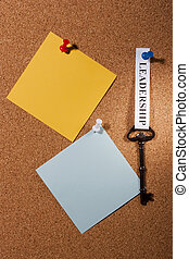 Key to Leadership - Key with a leadership tag pinned on a...