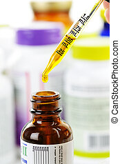 Medicine dropper and bottle - Closeup of liquid medicine in...