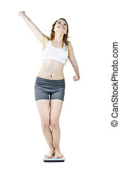 Excited fit young girl on bathroom scale - Happy joyful...