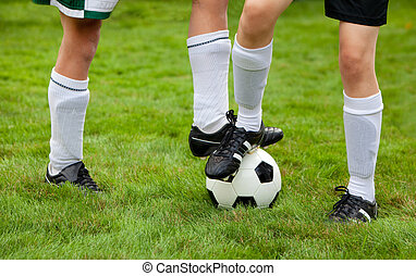 Soccer Players - Soccer players on the field and ball