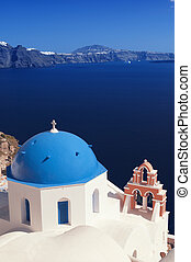Santorini, Greece - Orthodox church at Oia (Ia) village with...