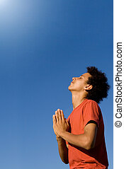 mixed race christian teen praying