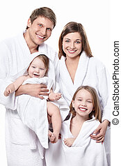 Happy family isolated - A family with two children in smocks...