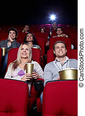 Happy people in the cinema - Smiling people are watching...