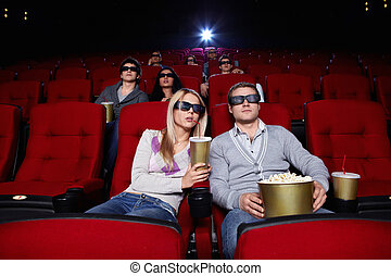 People watch movies in cinema - Young people watch movies in...