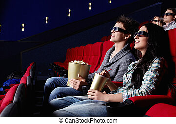 People in the cinema - Young attractive people in the cinema
