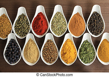 Cooking concept - Colorful spices in ceramic containers -...
