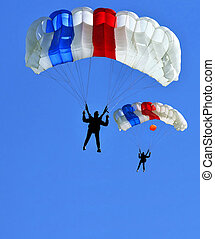 two parachutes - Two colorful parachutes on blue sky.