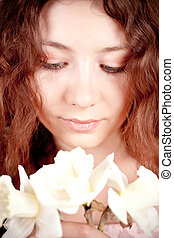 beautiful woman with narcissus - closeup portrait of...