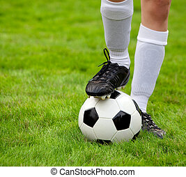 Soccerball  - Soccer player and soccerball on the field