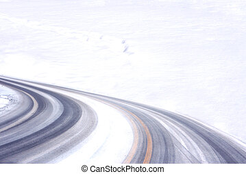 Tire Track - Curly tired tracks fading into snowfield for...