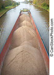 barge with sand on a canal