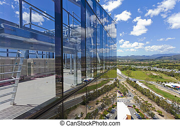 Modern Corporate Building with sky and clouds reflecting