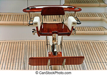 Fishing Chair on a Yacht - A luxury, wooden fishing chair on...