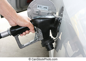 Gas refilling - Mans hand holding a gas pump