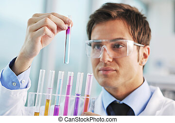 doctor scientist in labaratory - young doctor scientist in...