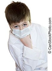 Portrait of a boy in a white robe and mask medical isolation