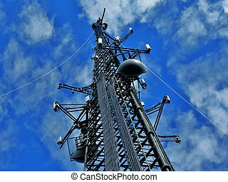 Communication Tower - Cell tower agaist a bright blue sky...