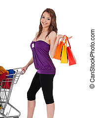 Pretty girl with shopping cart and colorful bags