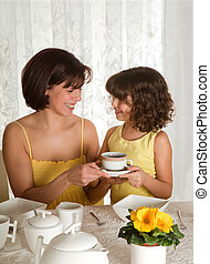 Coffee for mommy - Little girl serving coffee on mother's...