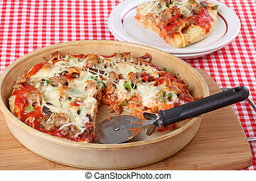 Deep Dish Pizza - Sausage and mushroom pizza in a deep dish...