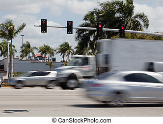 Traffic Light - Traffic light shows stop with cars and...