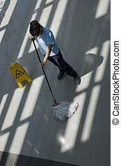 cleaning - A worker is cleaning the floor