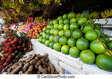 Piles of Limes and Other Fruit in Cambodian Market -...