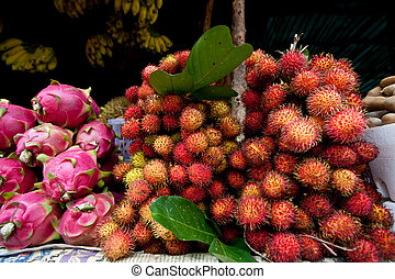 Close-up of Dragon Fruit and Rambutan in Market - Cambodia,...
