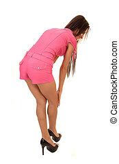 Girl bending down.