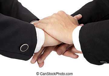 Trust and cooperation concept stacked hands of businessman