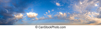 White clouds on blue sky panorama. Month of April, evening.