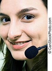 Close-up face of smiling woman in headphones