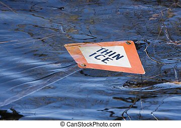 Thin Ice sign floating in the water