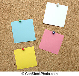 Cork bulletin board with pinned blank papers