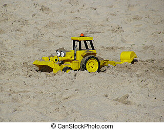 Toy  dozer  - Yellow toy  dozer  in sand