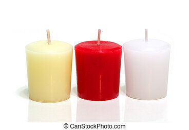 Candles - Three colored candles isolated on white background