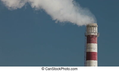 Smokestack - Industrial smokestack with billowing white...