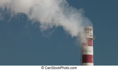 Chimney - Industrial smokestack with billowing white smoke...