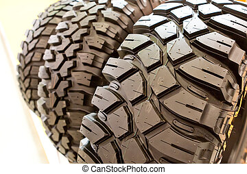 Backgorund of many black rubber tyres with torns