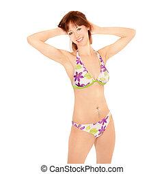 Portrait of beautiful young woman in colorful bikini