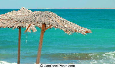 Wooden umbrella on empty beach - Canopy in the form of...