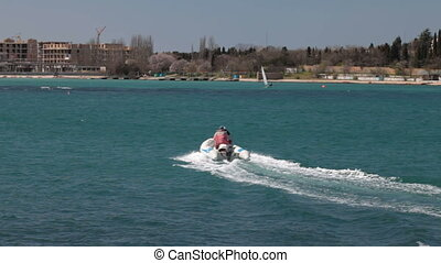 speed boat carving body of water - speed boat carving up...