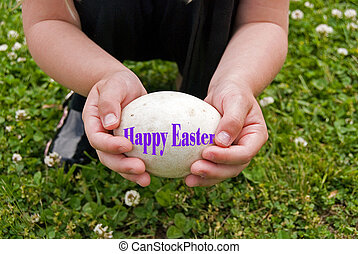 Easter Goose Egg - Little girl holding an Easter goose egg.